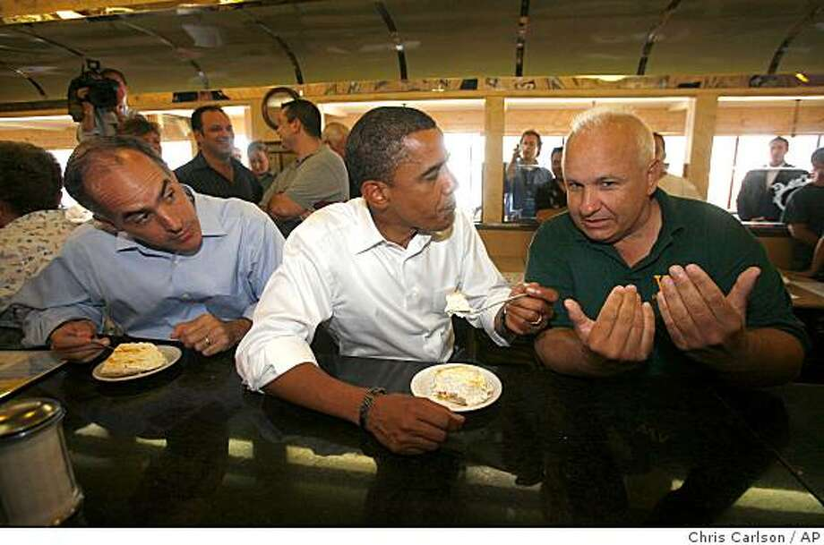 Democratic presidential candidate Sen. Barack Obama, D-Ill., center, talks with Sam Agolino of West Pittston, Pa. as Sen. Bob Casey, D-Pa. looks on at left during a campaign stop at the Avenue Diner in Wyoming, Pa., Friday, Sept. 5, 2008.  (AP Photo/Chris Carlson) Photo: Chris Carlson, AP