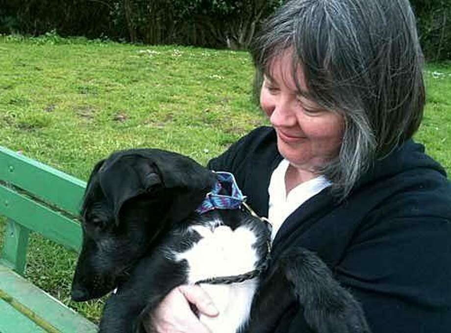 The columnist with her puppy Rawley, then 12 weeks old. Photo: Gina Spadafori