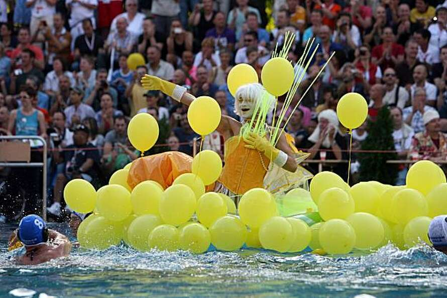 A man performs in the freestyle competition of the waterballet event on the pink friday party of the