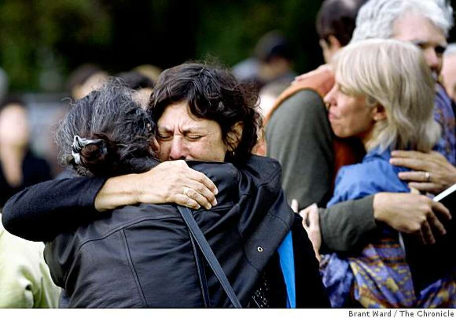 Judith McKay, facing camera, the mother of Jordan McKay,  gets a hug from a friend as cyclists gathered at Golden Gate Park for a memorial bicycle ride in honor of Jordan, who was shot and killed riding his bicycle on September 17, 2008 near the corner of Cabrillo and 15th Streets. Photo: Brant Ward, The Chronicle