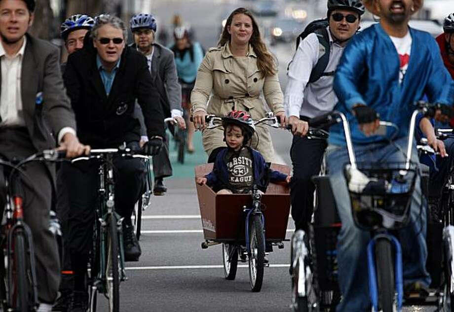 Three-year-old Sidney Goldfader-Dufty, Supervisor Bevan Dufty's daughter, hitches a ride with Kit Hodge on Bike to Work Day in San Francisco, Calif., on Thursday, May 13, 2010. Photo: Paul Chinn, The Chronicle