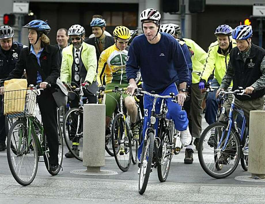 It's Bike to Work day. S.F. Mayor Gavin Newsom leaves the Ferry Building for a ride up Market Street. Photo: Scott Sommerdorf, SFC