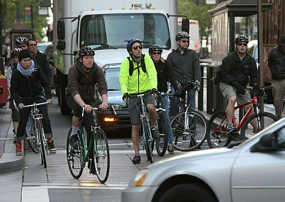 Bicyclists wait at a stoplight as they ride their bikes down Market Street on Bike to Work Day last year. This year, Bike to Work Day is May 13. Photo: Justin Sullivan, Getty Images