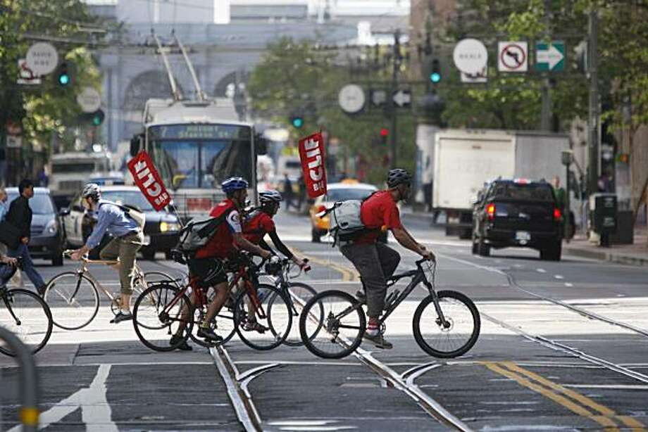 The Cliff Bar team rides across Market Street during the 15th annual Bay Area Bike to Work day. Photo: Mike Kepka, The Chronicle