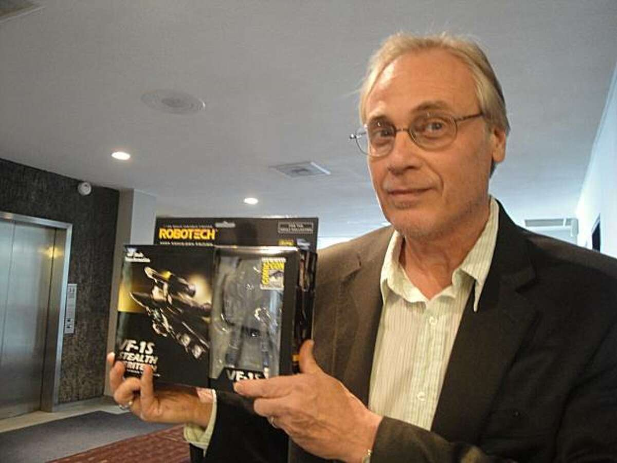 Carl Macek holds up one of the popular transforming toys that became a merchandising legacy of the Robotech series.