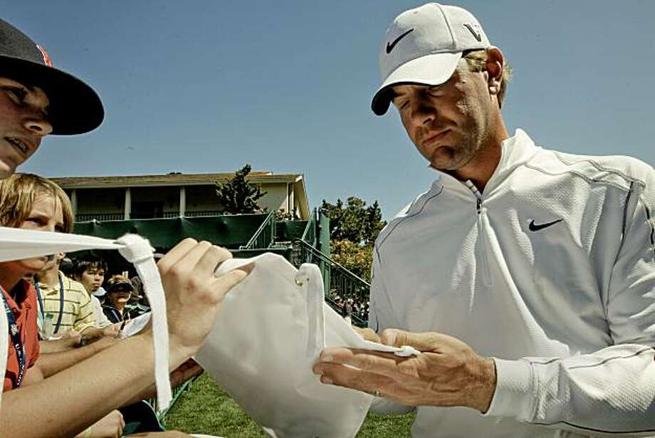 Lucas Glover signs autographs following his final practice round a day before the start of the 2010 US Open Golf Tournament in Pebble Beach, Ca. on Wednesday June 16, 2010. Photo: Michael Macor, The Chronicle