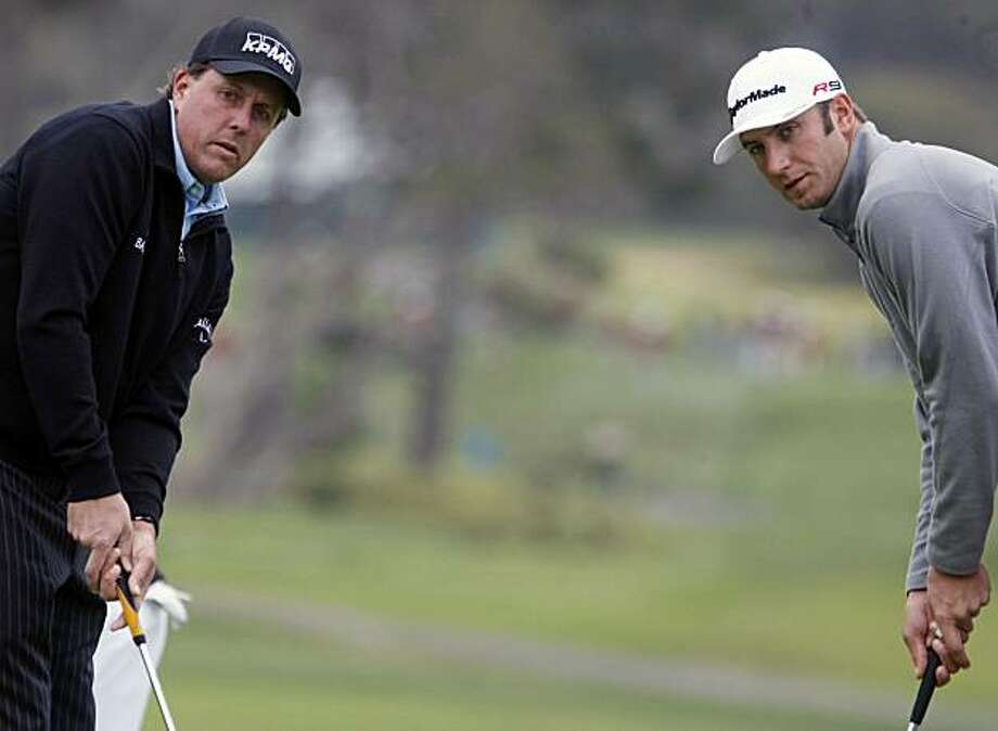 Phil Mickelson and Dustin Johnson line up their putts on 13th green as practice rounds for the US Open continued Tuesday June 15, 2010 at Pebble Beach Gold Links. Photo: Lance Iversen, The Chronicle
