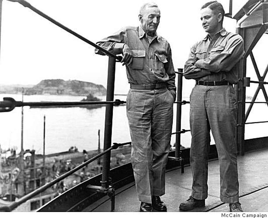 In this Sept. 2, 1945 black-and-white file photo provided by the McCain Presidential Campaign shows John McCain's father and grandfather on the bridge of a submarine tender USS Proteus, in Tokyo Bay a few hours after WWII had ended. It was the last time father and son saw each other. The son was 34 and a submarine commander. His crew had just brought a surrendered Japanese sub into the bar. Gramps, 61, had just relinquished command of a carrier task force and had attended the signing of the Japanese surrender aboard the USS Missouri that morning. He died of a heart attack several days later. Photo: McCain Campaign