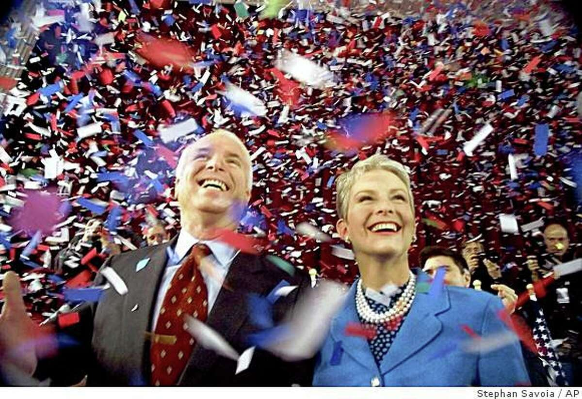 Republican presidential candidate Sen. John McCain, R-Ariz., and his wife Cindy, smile as confetti falls on them at the end of their 114th New Hampshire town hall meeting with voters at the Peterborough Town House in Peterborough, N.H., Sunday afternoon Jan 30, 2000.