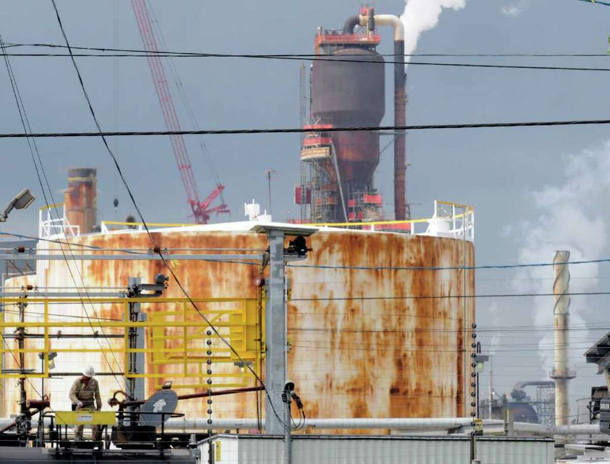 A man works at ExxonMobil's Baytown refinery in September 2009. The refinery ranked among America's top 50 emitters of greenhouse gases, EPA data shows.
