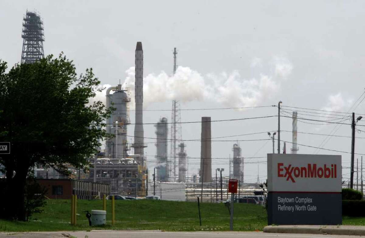 Steam rises from towers at ExxonMobil's Baytown refinery in April 2010. The refinery ranked among America's top 50 emitters of greenhouse gases, EPA data shows.