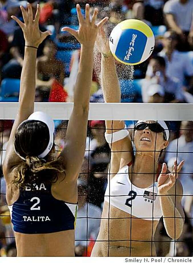Misty May-Treanor of the USA hits the ball past Talita Rocha of Brazil during women's beach volleyball semifinals at the 2008 Summer Olympic Games, Tuesday, Aug. 19, 2008, in Beijing. The pair of Walsh/May-Treanor defeated Brazil's Talita/Renat 2-0. ( Smiley N. Pool / Chronicle ) Photo: Smiley N. Pool, Chronicle