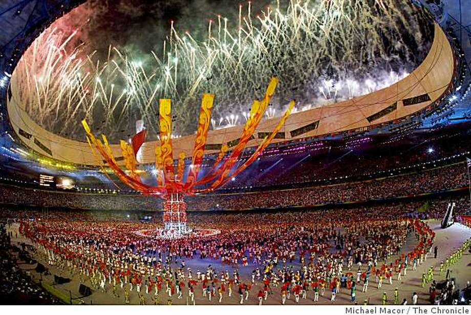 The National Stadium comes alive with fireworks and vibrant colors as closing ceremonies bring an end to the the 2008 Olympics in Beijing, China on Sunday Aug. 24, 2008. Photo: Michael Macor, The Chronicle