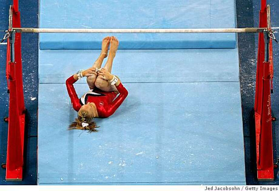 BEIJING - AUGUST 10:  Nastia Liukin of the United States falls of off the uneven bars during qualification for the women's artistic gymnastics event held at the National Indoor Stadium during Day 2 of the 2008 Summer Olympic Games on August 10, 2008 in Beijing, China.  (Photo by Jed Jacobsohn/Getty Images) Photo: Getty Images