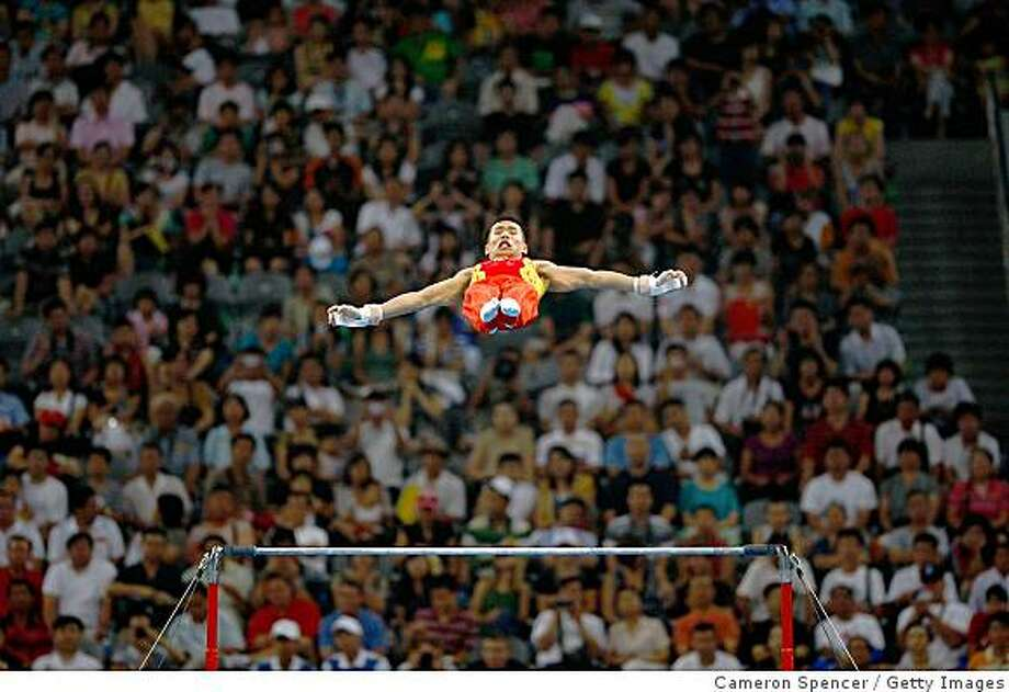 BEIJING - AUGUST 09:  Xiao Qin of China competes on the horizontal bar during the artistic gymnastics event held at the National Indoor Stadium during Day 1 of the 2008 Beijing Summer Olympics on August 9, 2008 in Beijing, China.  (Photo by Cameron Spencer/Getty Images) Photo: Getty Images