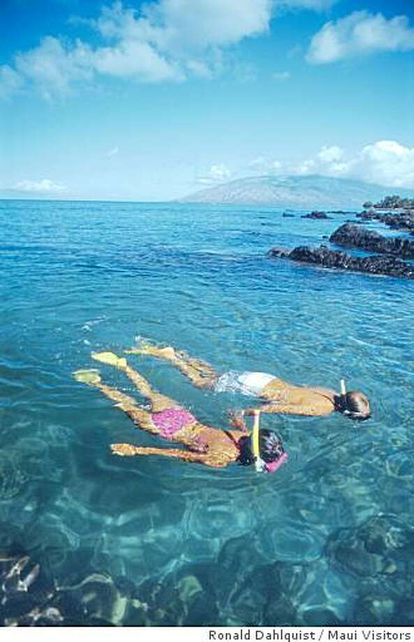 Couple snorkeling off the coast of Maui. Photo: Ronald Dahlquist / Maui Visitors