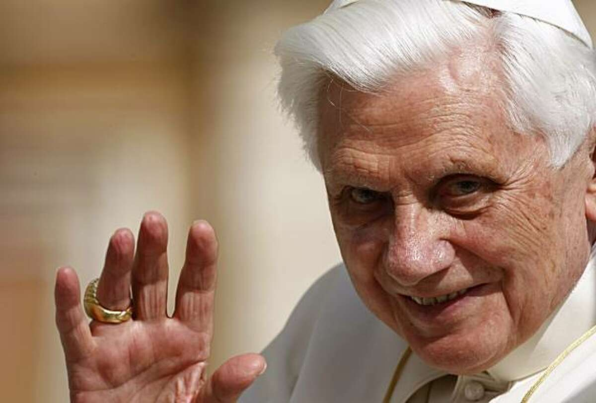 In this March 31, 2010 photo, Pope Benedict XVI waves as he is driven through the crowd during his weekly general audience, in St. Peter's Square, at the Vatican. The uproar caused by reports that, as an archbishop years ago in Germany and lateras a Vatican cardinal, Benedict and his aides were slow to defrock abusive priests, cannot be explained as the church equivalent of Watergate with the pope in the role of U.S. president.