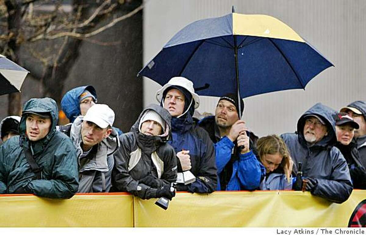 Crowds of hundreds wait in the rain to see professional cyclist ride the first stage of the Amgen Tour of California, Sunday Feb. 15, 2009, in Santa Rosa, Calif.