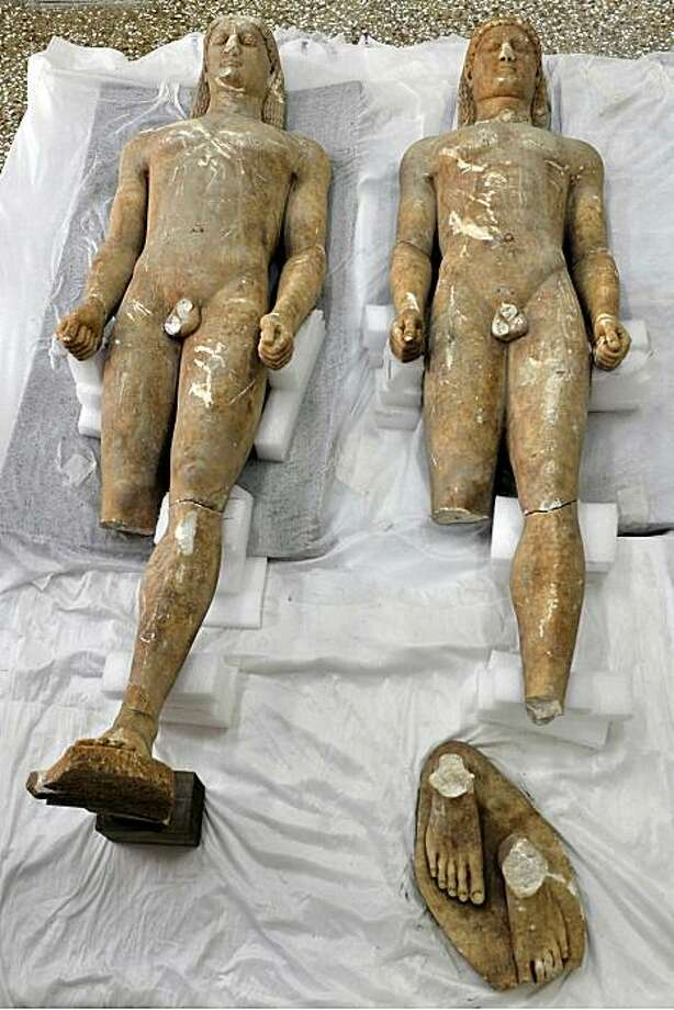 'Kouros' marble male statues dated from the 6th century BC are presented to the media at a workshop at the Archaeological museum of Athens on May 18, 2010. The two statues were found by police in the hands of illegal antique dealers in the area of Corinthon May 14. Photo: Louisa Gouliamaki, AFP / Getty Images