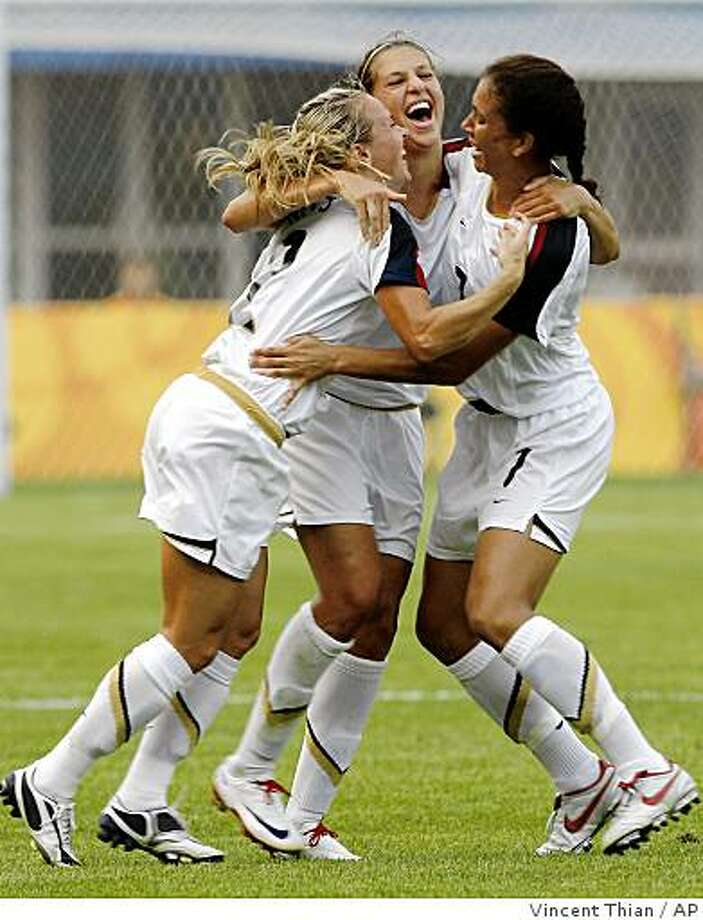 The United States' Carli lloyd, center, is embraced by teammates Heather Mitts, left, and Shannon Boxx, after scoring a goal against Japan during a Beijing 2008 Olympics Group D first round women's soccer match in Qinhuangdao, China, Saturday, Aug. 9, 2008. (AP Photo/Vincent Thian) Photo: Vincent Thian, AP