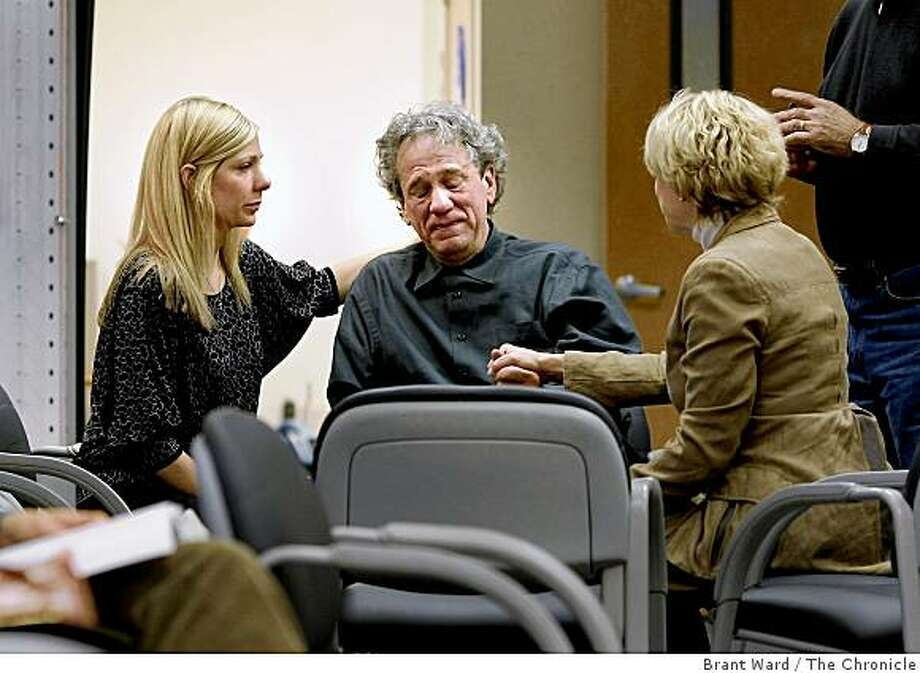 Dr. Richard Beller (center) was consoled by Dr. Joelle Zarzana (left) and Dr. Michelle Kerr (back to camera) after learning of the death of their colleague, Dr. Erin Jacobson. A plane crash in Montana took the lives of 14 Californians including the Jacobson family of five from St. Helena, CA. Photo: Brant Ward, The Chronicle