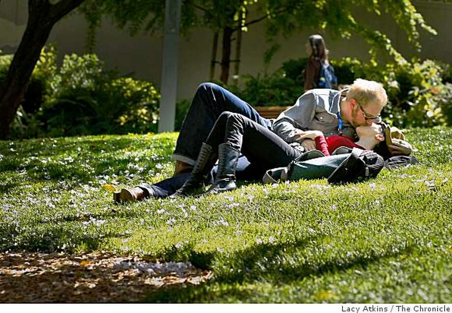"""""""Doctor Popular"""" and girlfriend Erica Mulkey enjoy the afternoon sun during a lunch break, Thursday March 26, 2009, at Yerba Buena Gardens, in San Francisco, Calif. Photo: Lacy Atkins, The Chronicle"""