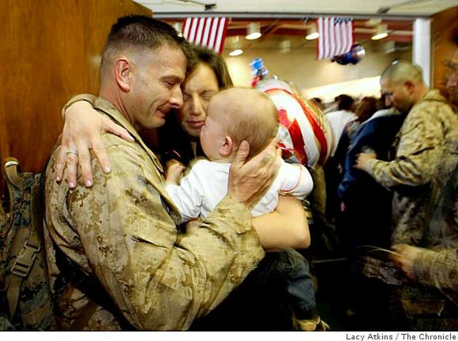 Chris Meade( left) is greeted by wife Katerina and their son Dominik when he returns from a seven month deployment to Iraq, Sunday Feb. 22, 2009, in San Bruno, Calif. When he left his son was only eight months. Photo: Lacy Atkins, The Chronicle