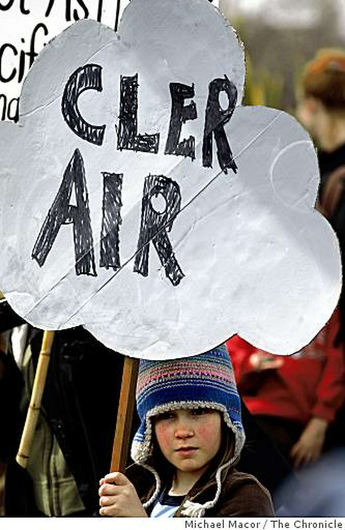 10 year-old Sasha Barish with her homemade sign she carries as she joins residents and local environmentalist at a protest march, on Feb 21, 2009, to Pacific Steel Casting Co., a Berkeley, Calif. firm they accuse of fouling the air and making life in the area unhealthy.