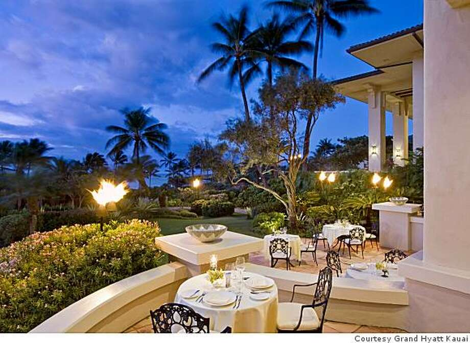 Dondero's dining room has a view of tropical gardens overlooking the ocean on Kauai's South Shore. Photo: Courtesy Grand Hyatt Kauai