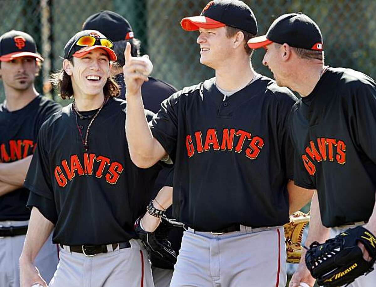 Giants pitchers Tim Lincecum (left) and Matt Cain enjoyed a light moment during an infield drill Friday February 26, 2010. Scenes from the San Francisco Giants and Oakland Athletics spring training campaigns of 2010 in Scottsdale and Phoenix, Arizona.
