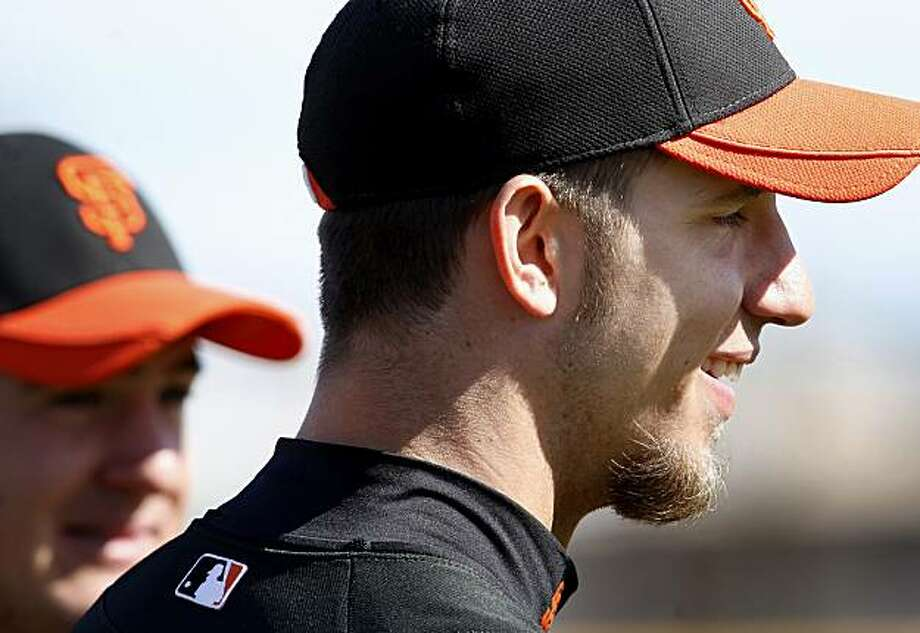Giants pitcher Madison Bumgarner smiled as he watched a pitching drill Friday February 26, 2010. Scenes from the San Francisco Giants and Oakland Athletics spring training campaigns of 2010 in Scottsdale and Phoenix, Arizona. Photo: Brant Ward, The Chronicle