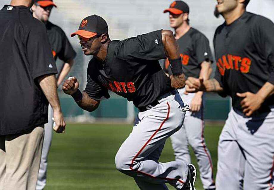 The Giants Fred Lewis takes off in a sprint during a morning workout Friday February 26, 2010 at Scottsdale Stadium. Scenes from the San Francisco Giants and Oakland Athletics spring training campaigns of 2010 in Scottsdale and Phoenix, Arizona. Photo: Brant Ward, The Chronicle