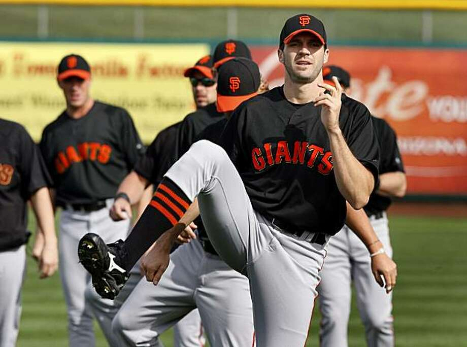 The Giants Barry Zito and others did their morning stretching and conditioning which requires getting into many positions Wednesday February 24, 2010 at Scottsdale Stadium. Scenes from the San Francisco Giants and Oakland Athletics spring training campaigns of 2010 in Scottsdale and Phoenix, Arizona. Photo: Brant Ward, The Chronicle
