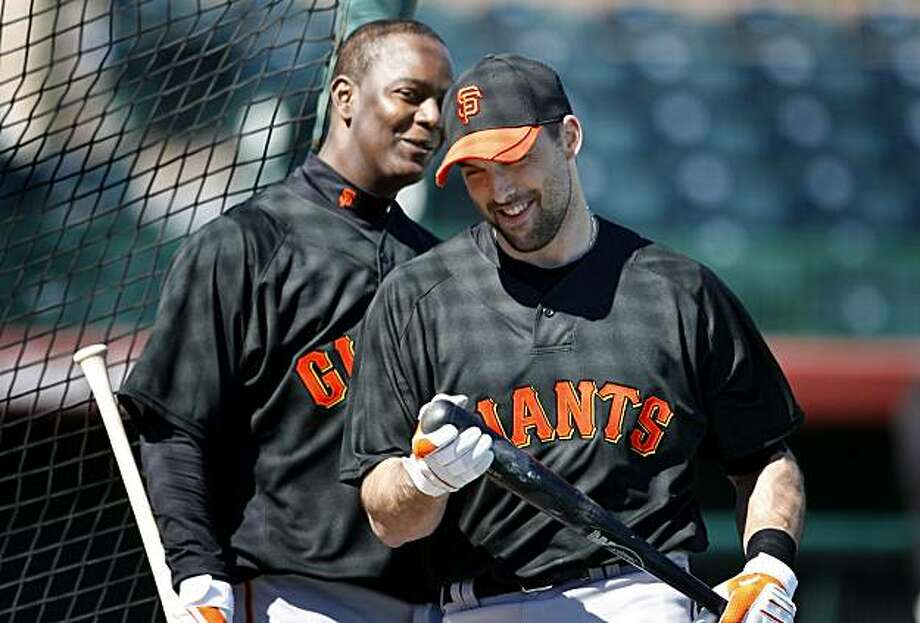 The Giants Edgar Renteria (left) and Mark DeRosa smiled as they passed each other during batting practice Tuesday February 23, 2010. Scenes from the San Francisco Giants and Oakland Athletics spring training campaigns of 2010 in Scottsdale and Phoenix, Arizona. Photo: Brant Ward, The Chronicle