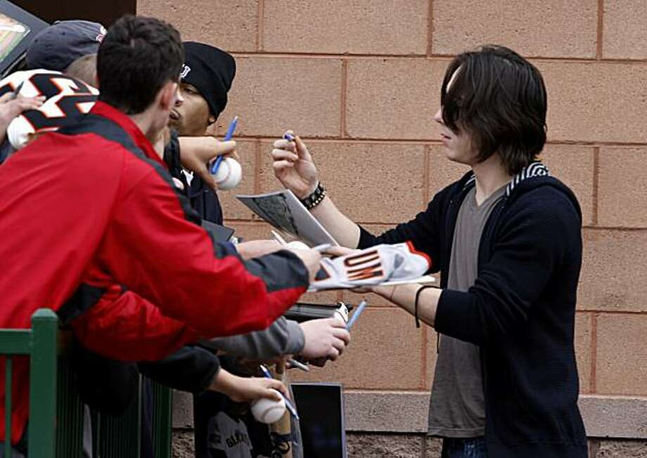 Pitcher Tim Lincecum stops to sign autographs to a few fans in front of Scottsdale Stadium before the Giants' workout Sunday. Photo: Brant Ward, The Chronicle