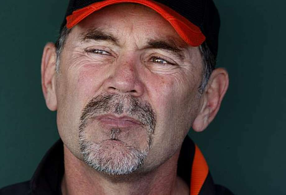San Francisco Giants manager Bruce Bochy contemplates a reporter's question in the dugout Sunday at spring training. Photo: Brant Ward, The Chronicle