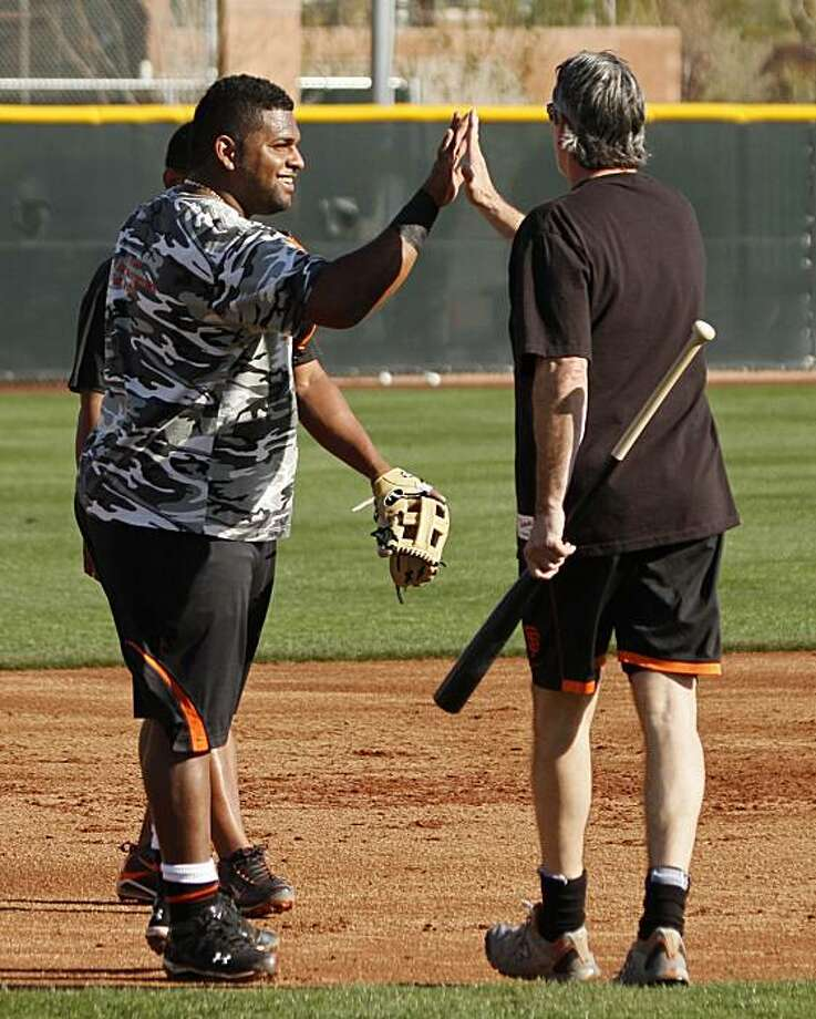 San Francisco Giants third baseman Pablo Sandoval, left, is greeting by bench coach Ron Wotus, right, during spring training baseball at Scottsdale Stadium in Scottsdale, Ariz., Wednesday, Feb. 17, 2010. Photo: Eric Risberg, AP