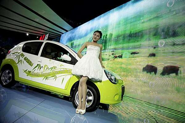 In this April 24, 2010 photo, the electric car EK-2 from Chinese automaker Geely is displayed at the Beijing Auto China 2010 show held in Beijing. Geely unveiled six alternative energy vehicles, some of which it said it plans to release by next year. Geely shot to prominence abroad in March when it agreed to buy Volvo Cars from Ford Motor Co. for $1.8 billion. The first Chinese-made car to hit the U.S. market might be an all-electric minivan that skips over gasoline technology and gets a head start on theauto industry's next era.