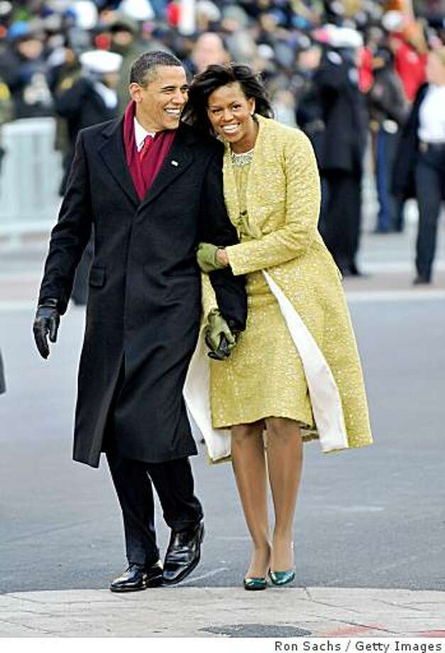 President Barack Obama and first lady Michelle Obama walk in the Inaugural Parade on January 20, 2009 in Washington, DC. Obama was sworn in as the 44th President of the United States, becoming the first African-American to be elected President of the US.  Photo: Ron Sachs, Getty Images