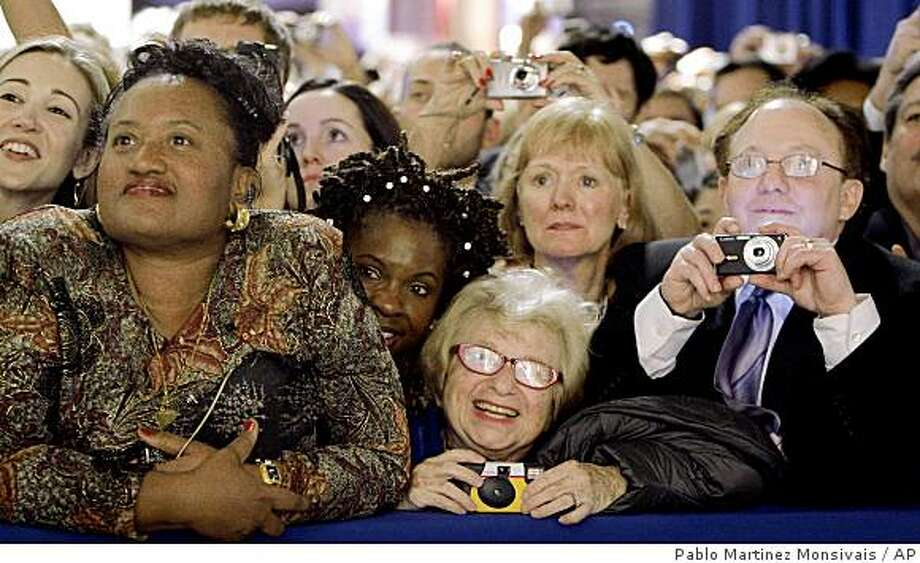 Dr. Ruth Westheimer, center, in the front-row watches President Barack Obama and first lady Michelle Obama at the Western Inaugural Ball in Washington, Tuesday, Jan. 20, 2009. Photo: Pablo Martinez Monsivais, AP