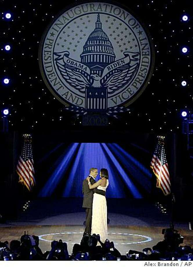 President Barack Obama, left, and first lady Michelle Obama dance together at the Neighborhood Inaugural Ball in Washington, Tuesday, Jan. 20, 2009. Photo: Alex Brandon, AP