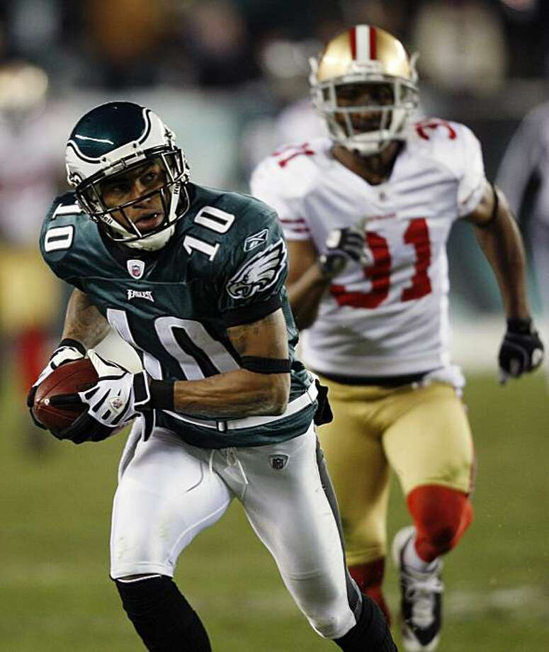 Philadelphia Eagles' DeSean Jackson, left, runs after catching a pass as San Francisco 49ers' Dre' Bly tries to chase him down in the second half of an NFL football game, Sunday, Dec. 20, 2009, in Philadelphia. Philadelphia won 27-13. (AP Photo/Mel Evans) Photo: Mel Evans, AP