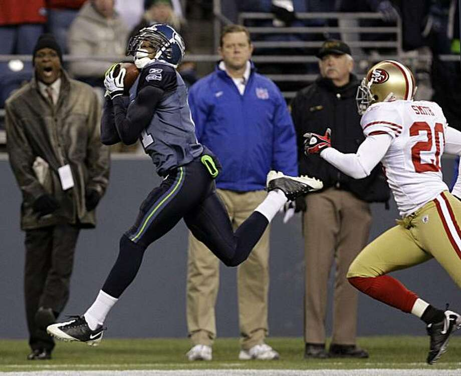 Seattle Seahawks' Deon Butler catches a 32-yard pass in front of San Francisco 49ers Keith Smith with 12 seconds left in the fourth quarter during an NFL football game, Sunday, Dec. 6, 2009, in Seattle. The Seahawks won 20-17. (AP Photo/Elaine Thompson) Photo: Elaine Thompson, AP