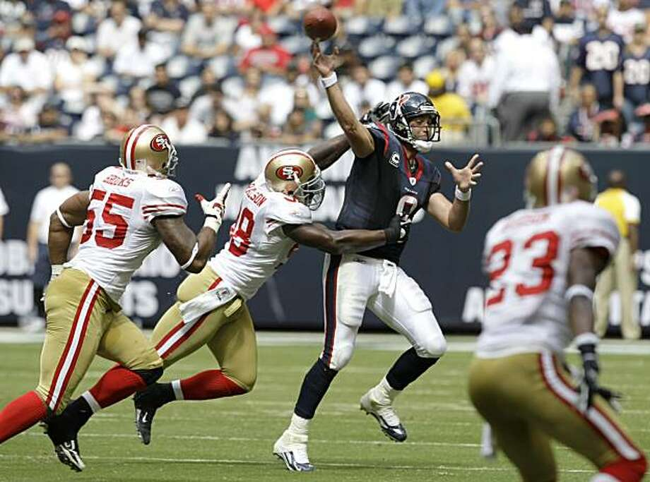 Houston Texans quarterback Matt Schaub (8) is pressured by San Francisco 49ers Parys Haralson (98) and Ahmad Brooks (55) during the 2nd quarter of an NFL football game at Reliant Stadium Sunday, Oct. 25, 2009, in Houston. Photo: Brett Coomer, Chronicle