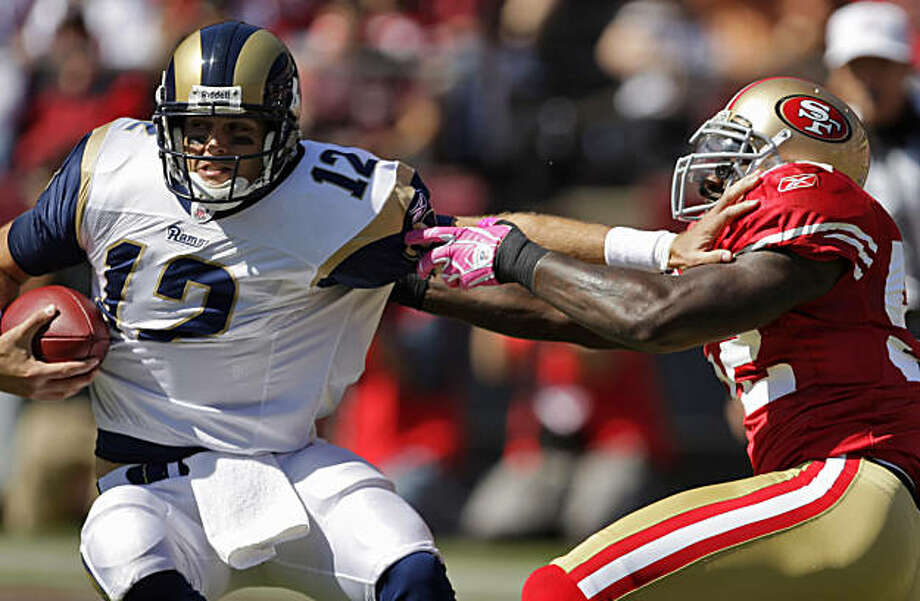 The Rams' Kyle Boller is sacked by 49ers linebacker Patrick Willis in the first quarter at Candlestick Park in San Francisco on Sunday. Photo: Carlos Avila Gonzalez, The Chronicle