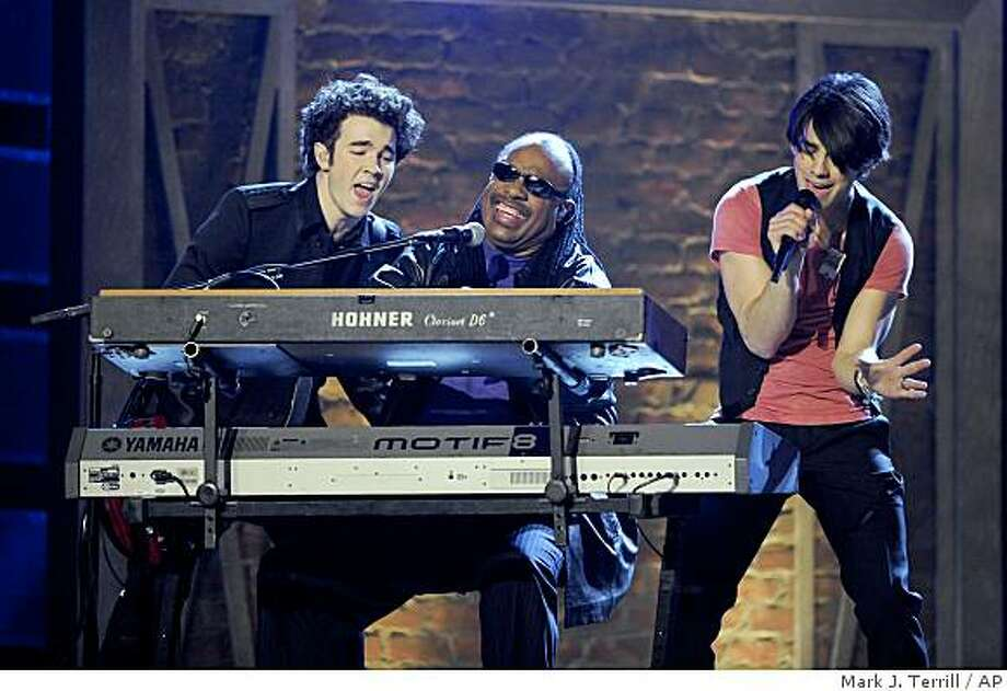"Kevin Jonas, left, and Joe Jonas, right, of the ""The Jonas Brothers"" perform with Stevie Wonder at the 51st Annual Grammy Awards on Sunday, Feb. 8, 2009, in Los Angeles. Photo: Mark J. Terrill, AP"