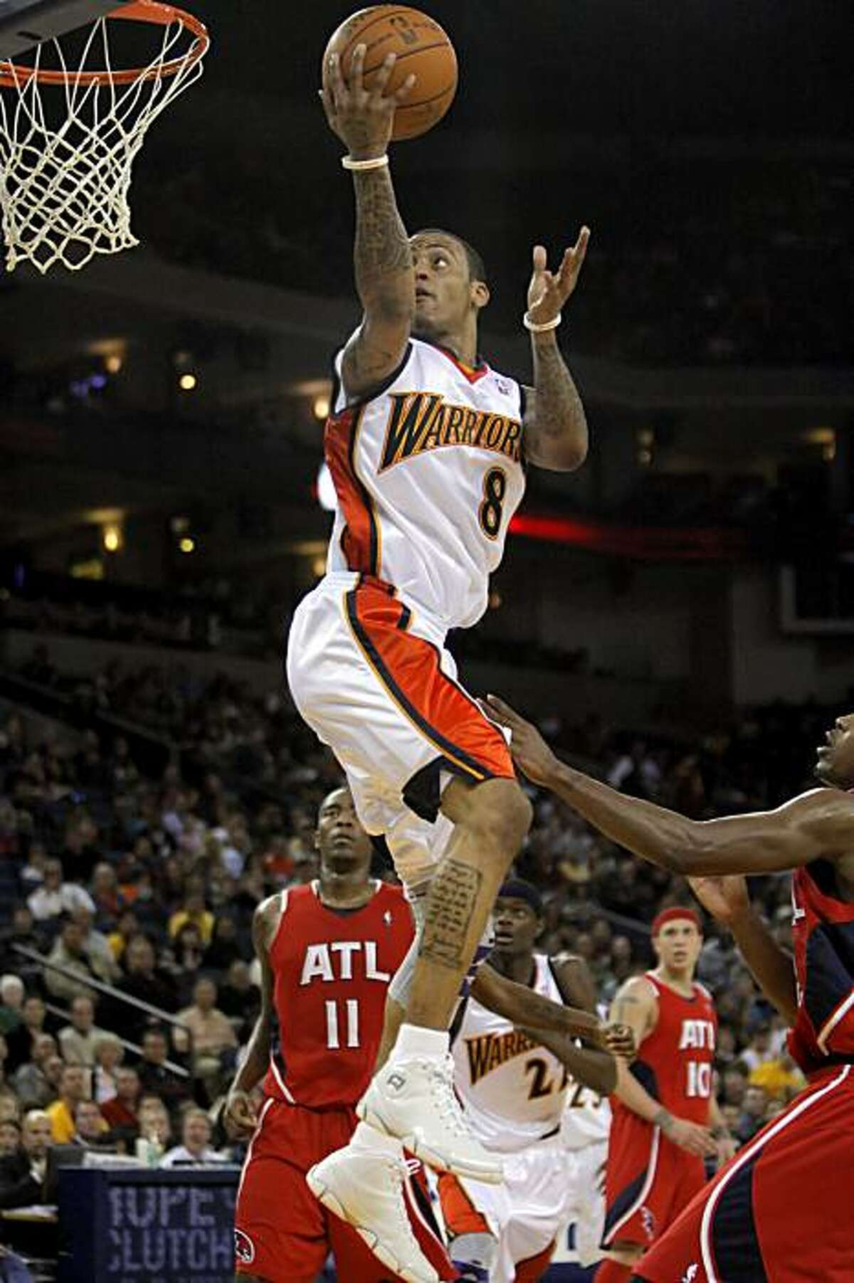 Monta Ellis puts up a shot in the first half of the Warriors' game against the Atlanta Hawks at Oracle Arena in Oakland on Sunday.
