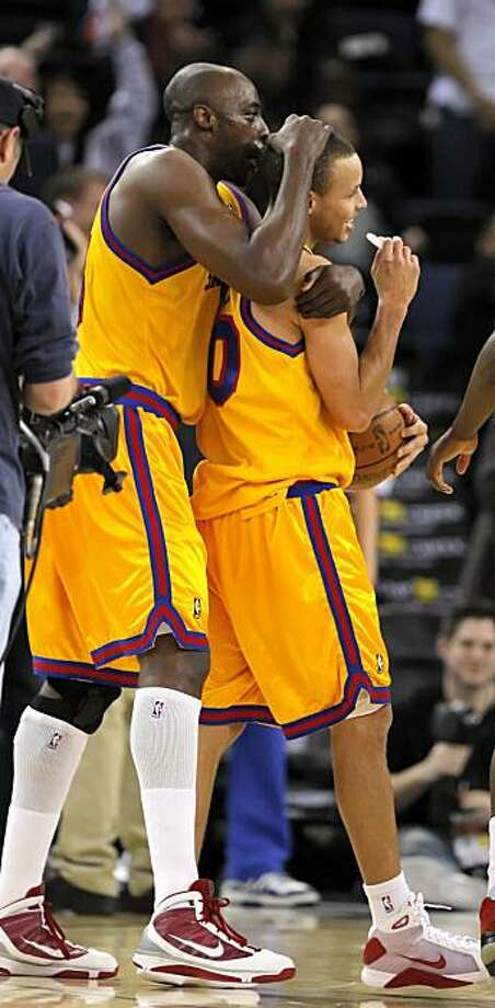 Warriors Anthony Tolliver, left, hugs rookie, Stephen Curry at the end of the game after Curry scored a triple double in the game against the Clippers. The Golden State Warriors played the Los Angeles Clippers in the Oakland-Alameda Country Arena in Oakland, Calif., on Wednesday, February 10, 2010. Photo: Carlos Avila Gonzalez, The Chronicle