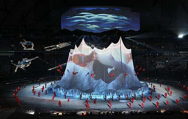Performers dance around a representation of the Rocky Mountains during opening ceremonies for the 2010 Winter Olympic Games at the BC Place Stadium on Friday, Feb. 12, 2010, in Vancouver. ( Smiley N. Pool / Houston Chronicle )Performers dance around a representation of the Rocky Mountains during opening ceremonies for the 2010 Winter Olympic Games at the BC Place Stadium on Friday, Feb. 12, 2010, in Vancouver. Photo: Smiley N. Pool, Houston Chronicle