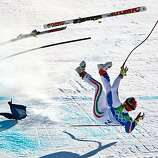Italy's Peter Fill crashes near the finish of the mens' alpine skiing Super G at the 2010 Winter Olympics on Friday, Feb. 19, 2010, in Whistler. ( Smiley N. Pool / Houston Chronicle)Italy's Peter Fill crashes near the finish of the mens' alpine skiing Super G at the 2010 Winter Olympics on Friday, Feb. 19, 2010, in Whistler.
